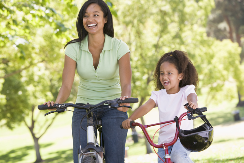 mom and daughter on bikes
